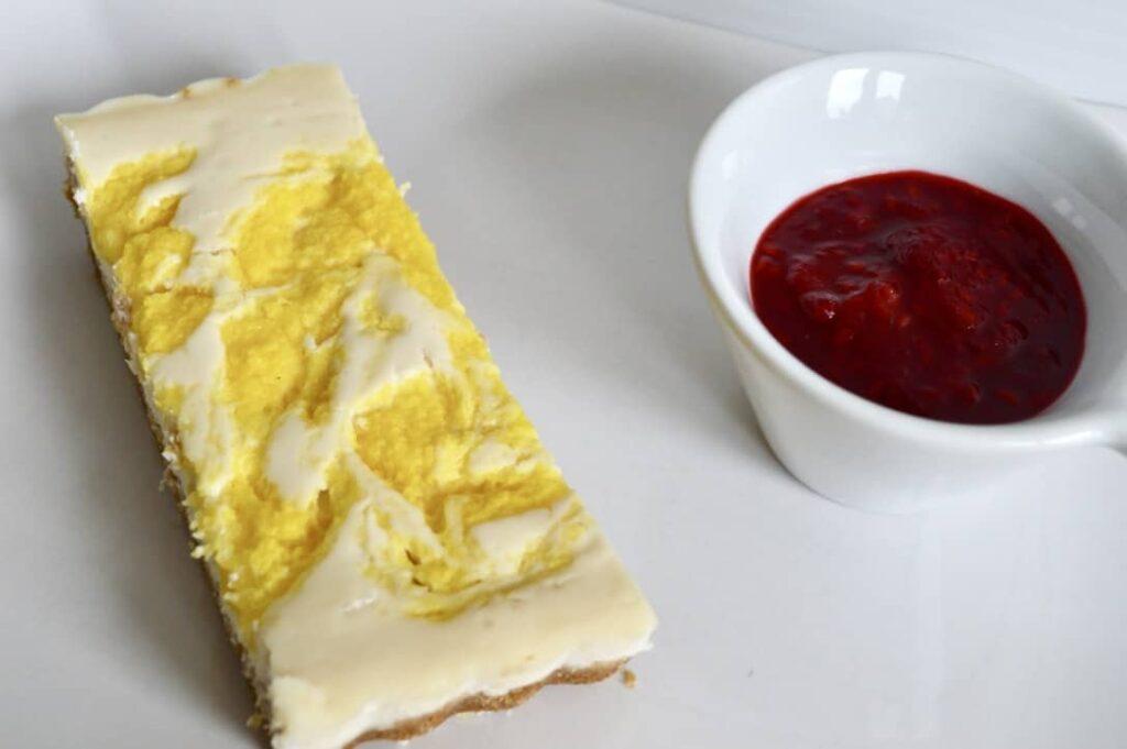 Gluten and Dairy Free Mango Swirl Cheesecake with Raspberry Sauce